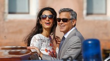 George Clooney and Amal Alamuddin pictured on Sunday in Venice.