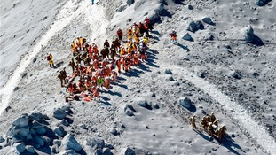 Japan Self-Defense Force (JSDF) soldiers and firefighters conduct rescue operations near the peak of Mt. Ontake.