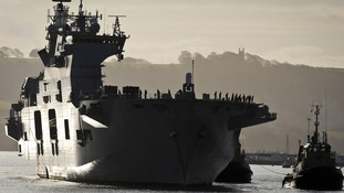 HMS Ocean arrives into the docks at Royal Naval Base Devonport Plymouth