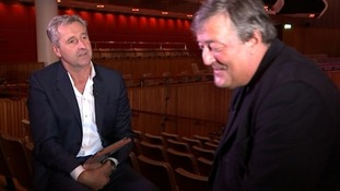 Stephen Fry (R) speaking to ITV News presenter Mark Austin