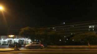 Police officers and military police stand guard outside Maadi military hospital,