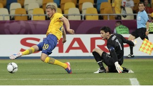 Sweden's Ola Toivonen misses a chance after going past France goalkeeper Hugo Lloris.