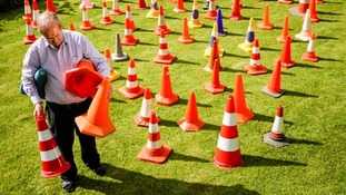 David Morgan, 72, from the Cotswolds, has the world's largest traffic cone collection and features in July.
