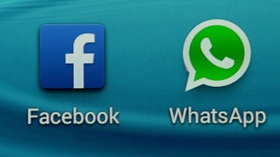 The logo of the messaging app WhatsApp and the logo of social networking site Facebook i