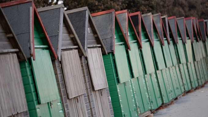 Lyme Regis residents camp out for beach huts like these