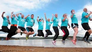 Competitors taking part in Kielder 10km and Run Bike Run jumping for joy.