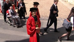 Aung San Suu Kyi arrives to receive her honorary degree in Oxford.