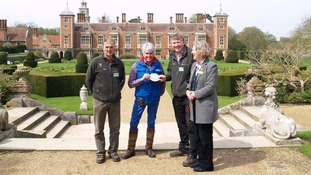 Alan Gray (in blue) presents Blickling's team with an award
