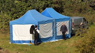 A private ambulance removed a body from a police tent, thought to be that of Latvian builder Arnis Zalkalns. Credit:
