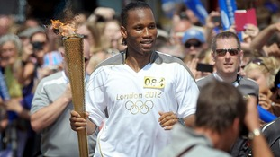 Didier Drogba runs with the Olympic Torch