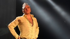 morrissey on stage in a shirt
