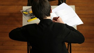A pupil sitting an exam in Cheltenham