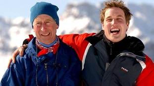 March 2004: The Prince of Wales with Prince William, enjoy a joke with the waiting Media above the Swiss village of Klosters