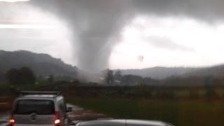 Eyewitnesses caught the tornado as it passed by their cars