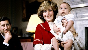 December 1982: The Prince and Princess of Wales at Buckingham Palace with baby son