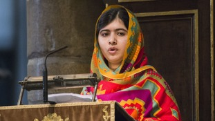 Malala speaking at Westminster Abbey.
