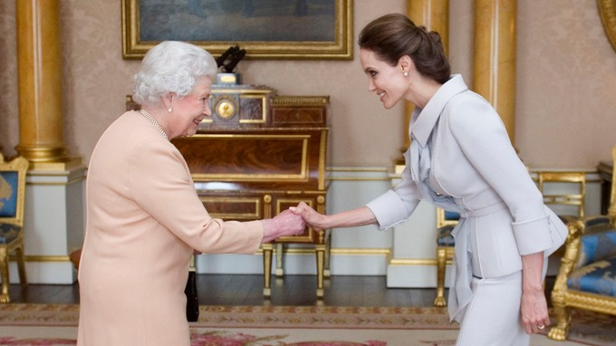 .Angelina Jolie is greeted by the Queen at Buckingham Palace.
