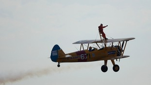 A 94-year-old daredevil has walked on a bi-plane as it flied around Gibraltar.