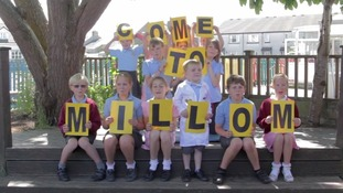 Youngsters hold up letters to spell out
