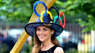 The Olympic Torch makes a surprise appearance at Ladies' Day at Royal Ascot