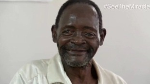 Winesi, who was blind, got to see his grandson for the first time
