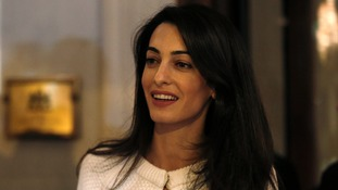 Human rights lawyer Amal Clooney makes statements after her arrival at a hotel in Athens yesterday