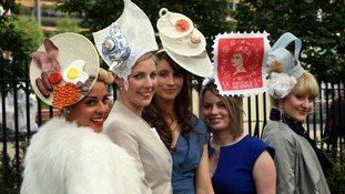 A patriotic look with afternoon tea, a full English breakfast and a crown atop these ladies' hats