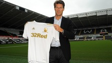 Michael Laudrup with Swansea shirt