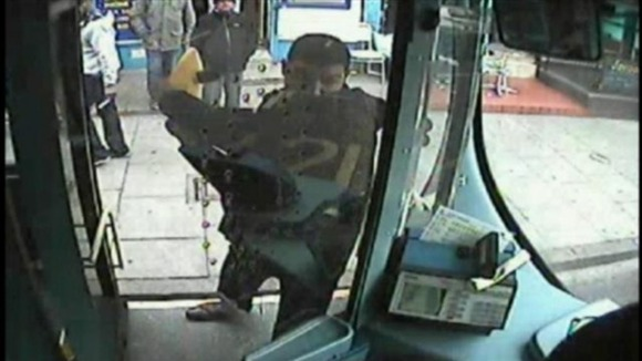 cctv image of a man attacking a bus