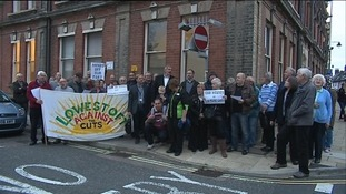 Protestors gathered outside the meeting this evening.