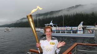 Flotilla helps Olympic Torch across Windermere