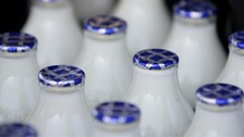 Protests over milk price cuts