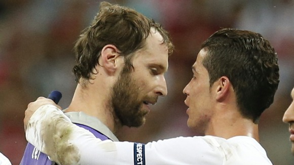 Cristiano Ronaldo chats with Czech keeper Petr Cech after the quarter-final.