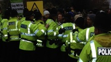 Image of police and crowds at Barton Moss.