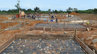 Local builders working on the construction of the UK Ebola Treatment Unit in Kerrytown in Sierra Leone
