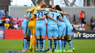 Manchester City Women huddling during a game