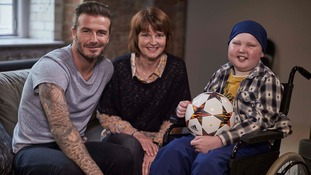 David Beckham chats to Lloyd Burton and his mother, Di