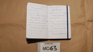 A notebook found in Vladimir Aust's room where he wrote down how to make HMTD, a power Mr Justice Coulson called