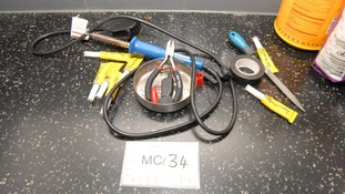 Vladimir Aust's worktop with switches, crocodile clips, bulbs and a battery which could be used to make a detonator.