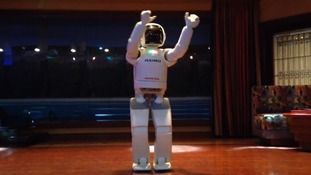 ASIMO the robot celebrates 'Friday dance party'