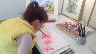 Vanessa learnt to paint holding the brush in her mouth as part of her rehabilitation following a spinal injury