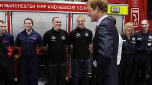 Prince Harry sharing a joke with Salford fire fighters on his last visit to Greater Manchester.
