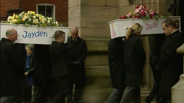Jayden and Jade Philpott's coffins are carried into church.