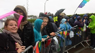 Crowds braving the rain in Morecambe as they wait for the relay