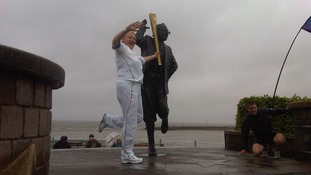 Torchbearer Victoria Brier poses with the Eric Morecambe statue