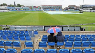 Lone spectators in the stand at Headingley.