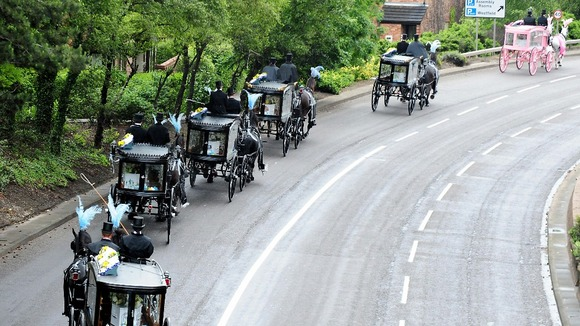 The horse-drawn carriages carrying the coffins, the pink carriage carrying Jade&#x27;s.