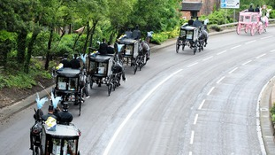 The horse-drawn carriages carrying the coffins, the pink carriage carrying Jade's.