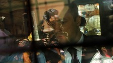 Oscar Pistorius is seen through the reflective window of a police van after his sentencing.