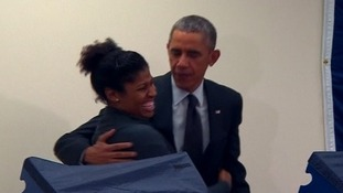 President Obama embraces a voter after her boyfriend's mocking threat